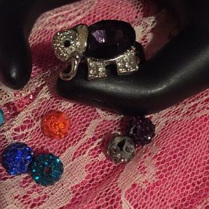 Fun silver elephant ring with purple stone